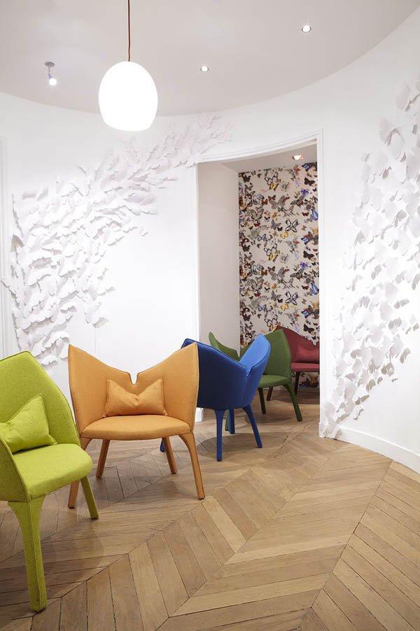 Oval room in white with herringbone wood flooring