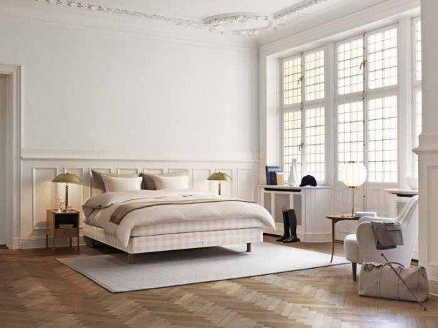 Limited edition bedroom with herringbone wood flooring